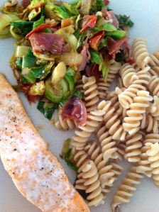 Wild salmon with pasta and spring greens